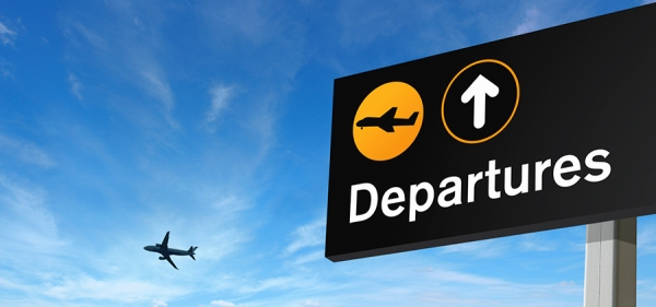 aeroplane and departure sign